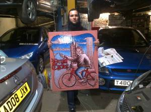 Alessandro from Italy with a Druid Cycles shop sign designed in memory of Barry Mason.